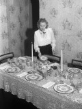 Young Woman Setting Dining Room Table Photographic Print by George Marks