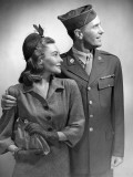 Man in Army Uniform With Woman Photographic Print by George Marks