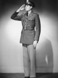 Man in Uniform Saluting in Studio Photographic Print by George Marks