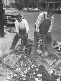Two Men Using Jackhammers on Sidewalk Photographic Print by George Marks