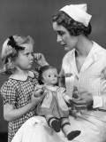 Nurse Consoling Young Girl and Her Doll Photographic Print by George Marks