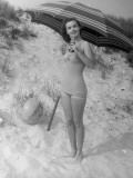 Woman Drinking Soda on Beach Photographic Print by George Marks