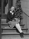 Young Woman Sitting on Steps Reading Photographic Print by George Marks
