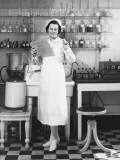 Nurse Standing in Laboratory Photographic Print by George Marks