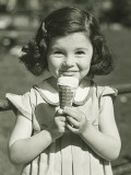 Girl Holding Ice Cream, Posing Outdoors Photographic Print by George Marks