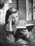 Woman Reading Book, Touching Forehead Photographic Print by George Marks