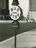 Bus Stop Sign on Sidewalk Photographic Print by George Marks