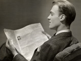 Businessman Reading Newspaper Photographic Print by George Marks