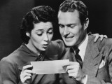 Young Couple Reading Telegram in Studio Photographic Print by George Marks