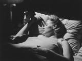 Young Woman Sleeping in Bed (B&W) Photographic Print by George Marks