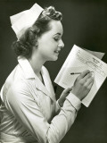 Nurse With Patient's Medical Chart Photographic Print by George Marks