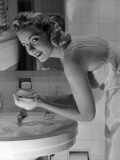 Woman Washing Face in Sink Photographic Print by George Marks