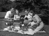 Two Couples Outdoors Having Picnic Photographic Print by George Marks