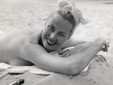 Woman Sunning and Smoking at Beach Photographic Print by George Marks