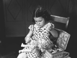 Girl (6-7) Sewing Doll's Clothing Photographic Print by George Marks