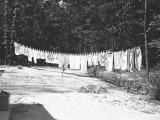 Laundry on a Clothesline Outdoors Photographic Print by George Marks