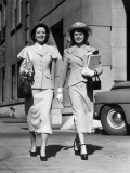 Two Women Walking With Packages Photographic Print by George Marks