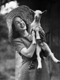 Woman Laughing and Holding a Goat Photographic Print by George Marks