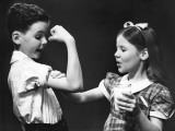 Boy Flexing Muscle For Girl Photographic Print by George Marks