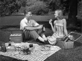 Couple Outdoors Having a Picnic Photographic Print by George Marks