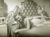 Woman Relaxing on Bed in Night Gown Photographic Print by George Marks