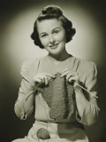 Young Woman Knitting in Studio, Portrait Photographic Print by George Marks