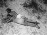 Couple Relaxing on Beach, Elevated View Photographic Print by George Marks