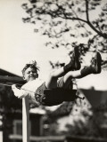 Small Boy on Swing Outdoors Photographic Print by George Marks