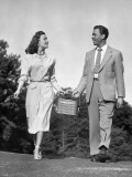 Man and Woman Holding Picnic Basket Photographic Print by George Marks