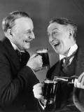 Two Men Enjoying Mugs of Beer Photographie par George Marks