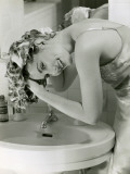 Woman Washing Her Hair in Sink Photographic Print by George Marks