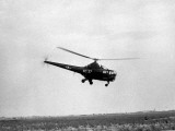 War Scene of Helicopter in Sky Photographic Print by George Marks