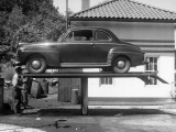 Automobile in Repair Shop Photographic Print by George Marks