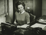 Young Woman Typing at Office Photographic Print by George Marks