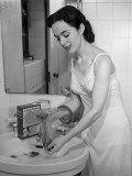 Woman Washing Her Hose at Bathroom Sink Photographic Print by George Marks