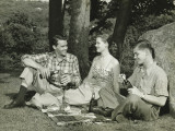 Woman and Two Men Picnicking Photographic Print by George Marks