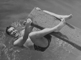Man Hanging on Diving Board Photographic Print by George Marks