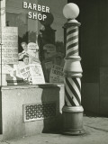 Striped Barber Pole Outside Shop Photographic Print by George Marks