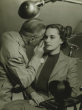 Optician Examining Woman's Eye Photographic Print by George Marks