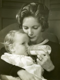 Mother Feeding Baby Girl Photographic Print by George Marks