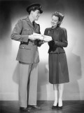 Soldier Handing Woman Box Photographic Print by George Marks