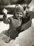 Boy Playing in Snow Photographie par George Marks