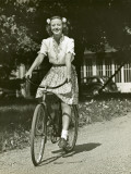 Woman on Bike Photographic Print by George Marks
