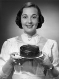 Woman Holding Cake Photographic Print by George Marks