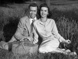 Couple Picnicking on Grass Photographic Print by George Marks
