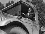 Woman Driving Truck Photographic Print by George Marks