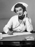 Nurse on the Phone Photographic Print by George Marks