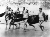 Surfers Running Photographic Print