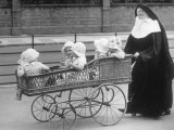 Nun and Babies Photographic Print