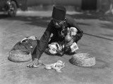 Snake Charmer Handling Snake Basket, Singapore Photographic Print by Charles Phelps Cushing